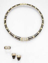 A DIAMOND AND BLACK ENAMEL SUI