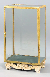 A GILT METAL AND CREAM PAINTED