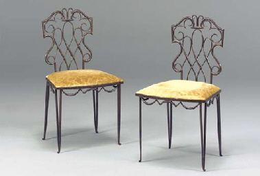 A PAIR OF PATINATED STEEL SIDE