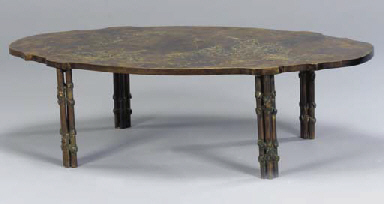 A BRONZE LOW TABLE WITH SHAPED