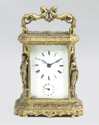 A French brass carriage timepi
