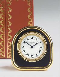 A Swiss brass travel alarm tim