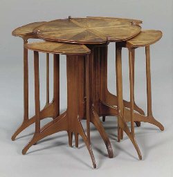 A NEST OF FIVE ROSEWOOD TABLES