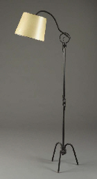 A WROUGHT-IRON FLOOR LAMP