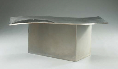A BRUSHED STEEL AND BLACK LEAT