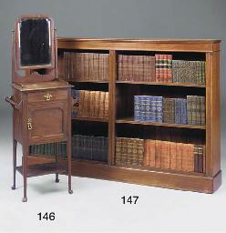 A mahogany open bookcase