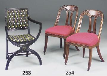 An ebonised x-framed armchair