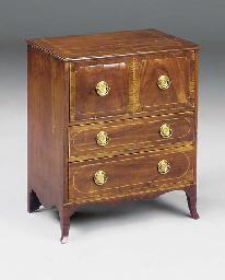 A mahogany inlaid and crossban