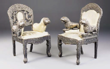 A pair of silvered metal thron