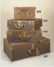 A Louis Vuitton hard suitcase,