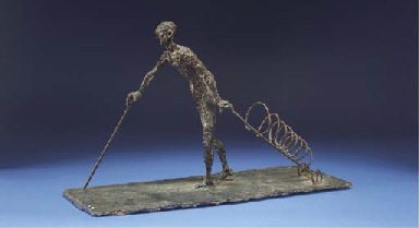 A man with walking stick and t
