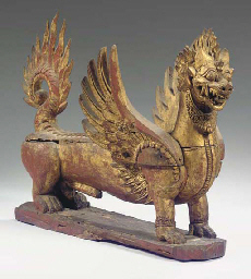a balinese gilt and red lacque