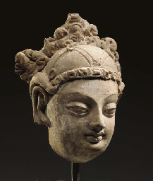 A Small Terracotta Head of a B