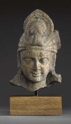 A Mottled Red Sandstone Head o