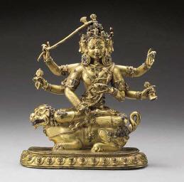 A Rare Gilt Bronze Figure of J