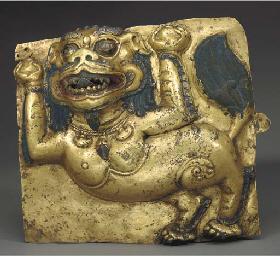 A Gilt Copper Repoussé Lion