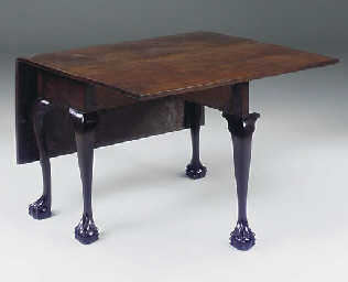 A mahogany drop leaf table