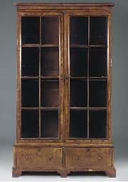 A WALNUT BOOKCASE