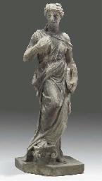 A sandstone garden statue of a