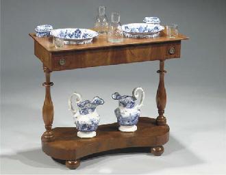 (11)  A Dutch mahogany wash st
