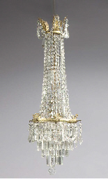 A cut-glass and brass chandeli