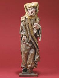 A polychrome carved wood figur