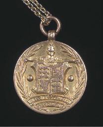 A 15CT GOLD INTERNATIONAL MEDA