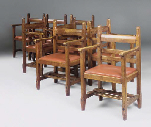 A SET OF EIGHT OAK LADDER BACK