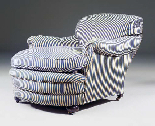 A 'HOWARD' TYPE EASY ARMCHAIR