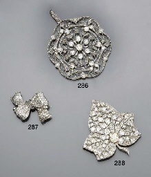 A diamond bow brooch by Garrar