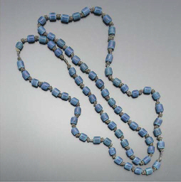 A SET OF LUSTRE BEADS BY OWEN