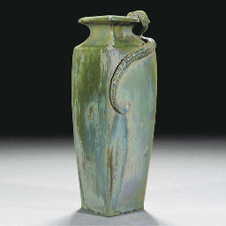 A CARTER'S LUSTRE VASE BY OWEN