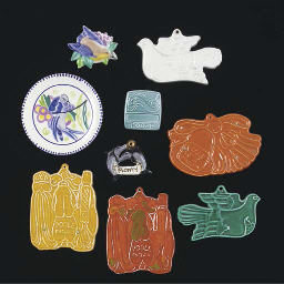A GROUP OF POOLE POTTERY BADGE