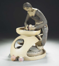 A POOLE POTTERY POTTER SEATED