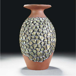 A POOLE POTTERY VASE IN THE ST