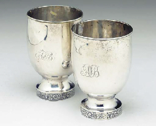 A SET OF FOUR SILVER-PLATED BE