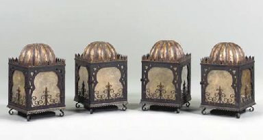 A SET OF FOUR BRONZED AND GILT