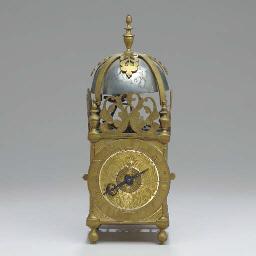 A SMALL BRASS LANTERN CLOCK WI