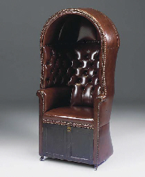 A BROWN LEATHER UPHOLSTERED PO
