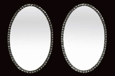 A PAIR OF OVAL FACET CUT GLASS