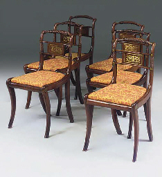 A SET OF SIX MAHOGANY AND BRAS