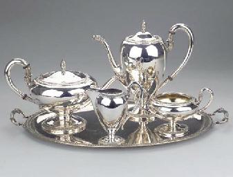 (5)  A four-piece silver tease
