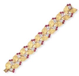 A DIAMOND, RUBY AND GOLD BRACE