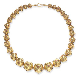 **A STYLISH GOLD AND MULTI-GEM