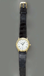 AN 18K GOLD WRISTWATCH, BY AUD