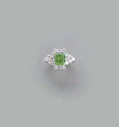 AN EMERALD, DIAMOND AND 18K WH