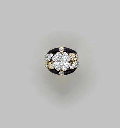 A DIAMOND, ONYX AND 18K TRI-CO