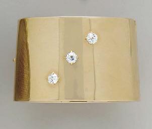 A GOLD AND DIAMOND CUFF BRACEL
