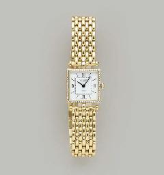 A DIAMOND AND 18K GOLD WRISTWA