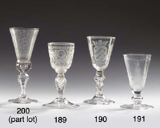 (2) A Dutch-engraved faceted armorial goblet and a Saxon engraved faceted...